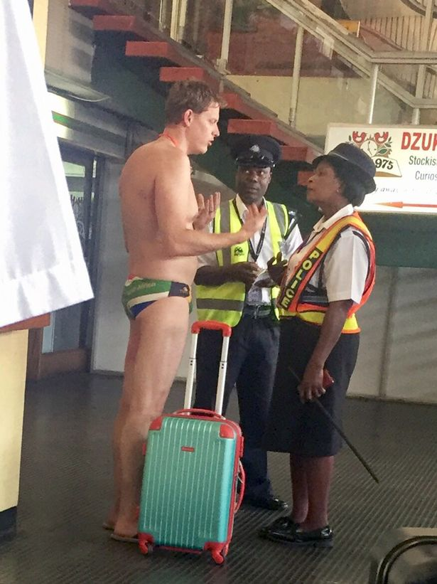pay-airport-man-in-trunks1