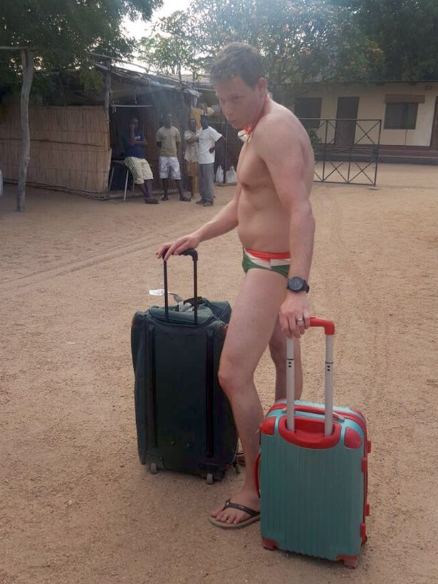 pay-airport-man-in-trunks3