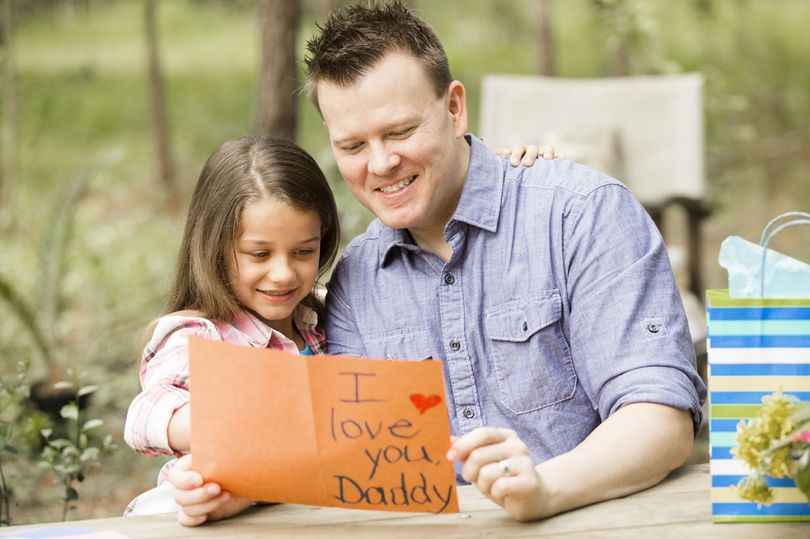 father-excitedly-receives-a-homemade-card-from-his-daughter